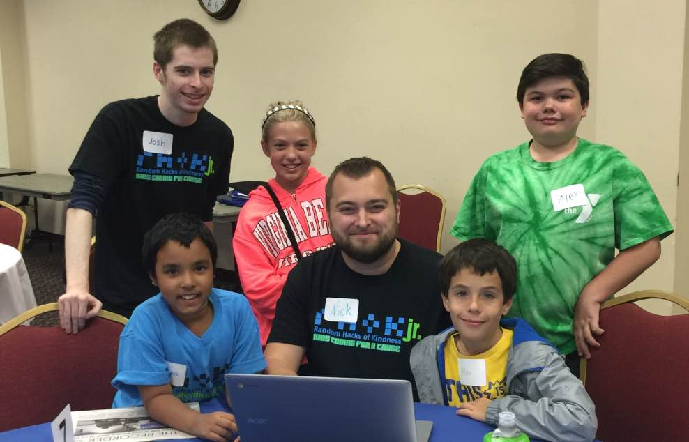 Mentors helping kids with coding