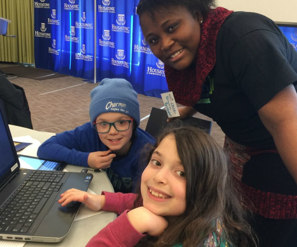 Mentors assisting kids to code